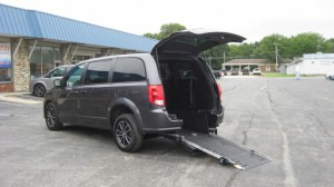 Used Wheelchair Van For Sale: 2018 Dodge Caravan  Wheelchair Accessible Van For Sale with a Adaptive Mobility Systems - Rear Entry Short Channel on it. VIN: 2C4RDGBG7JR139905