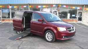 Used Wheelchair Van For Sale: 2018 Dodge Caravan  Wheelchair Accessible Van For Sale with a Adaptive Mobility Systems - Side Entry Dodge Grand Caravan on it. VIN: 2C4RDGCG0JR328300