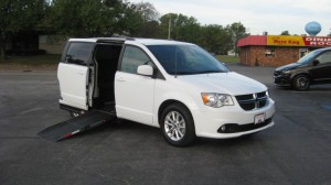 Used Wheelchair Van For Sale: 2018 Dodge Caravan  Wheelchair Accessible Van For Sale with a Adaptive Mobility Systems - Side Entry Dodge Grand Caravan on it. VIN: 2C4RDGCGXJR238314