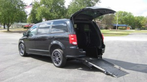 Used Wheelchair Van For Sale: 2018 Dodge Caravan  Wheelchair Accessible Van For Sale with a Adaptive Mobility Systems - Rear Entry Long Channel on it. VIN: 2C4RDGEG6JR275485