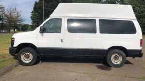 Used Wheelchair Van For Sale: 2009 Ford E-150 EL Wheelchair Accessible Van For Sale with a Nor-Cal Vans - NCV Commercial Wheelchair Transit on it. VIN: 1FMNE11W49DA33391