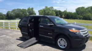Used Wheelchair Van For Sale: 2015 Ford Explorer LT Wheelchair Accessible Van For Sale with a BraunAbility - MXV Wheelchair SUV on it. VIN: 1FM5K7D82FGC52627