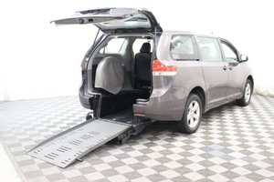 Used Wheelchair Van For Sale: 2014 Toyota Sienna  Wheelchair Accessible Van For Sale with a Braun Rampvan on it. VIN: 5TDZK3DCXES407190
