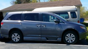 Used Wheelchair Van For Sale: 2015 Honda Odyssey EX Wheelchair Accessible Van For Sale with a Rollx Vans - Rollx In Floor Honda on it. VIN: 5FNRL5H45FB089139