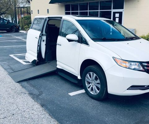 Used Wheelchair Van For Sale: 2016 Honda Odyssey Touring Wheelchair Accessible Van For Sale with a VMI - Honda Northstar on it. VIN: BO41599