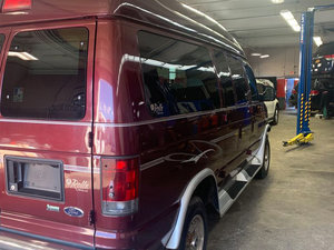 Used Wheelchair Van For Sale: 2012 Ford E-150  Wheelchair Accessible Van For Sale with a BraunAbility Lift on it. VIN: 20002
