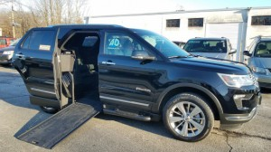 Used Wheelchair Van For Sale: 2018 Ford Explorer Limited Wheelchair Accessible Van For Sale with a BraunAbility - MXV Wheelchair SUV on it. VIN: 1FM5K7F80JGA70642