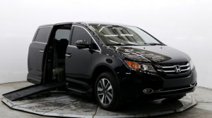 Used Wheelchair Van For Sale: 2016 Honda Odyssey Touring Wheelchair Accessible Van For Sale with a BraunAbility - Honda Entervan II on it. VIN: 5FNRL5H93GB034119