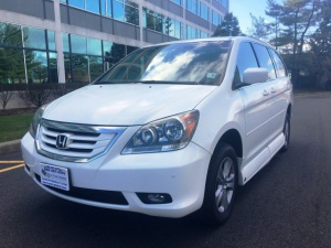 Used Wheelchair Van For Sale: 2010 Honda Odyssey Touring Wheelchair Accessible Van For Sale with a VMI Honda Northstar on it. VIN: 5FNRL3H99AB108767