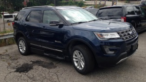 New Wheelchair Van For Sale: 2016 Ford Explorer LT Wheelchair Accessible Van For Sale with a BraunAbility MXV Wheelchair SUV on it. VIN: 1FM5K7D84GGC09621