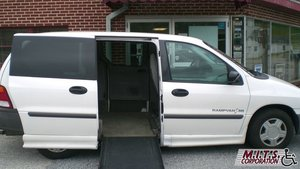 Used Wheelchair Van For Sale: 2002 Ford Windstar LX Wheelchair Accessible Van For Sale with a  on it. VIN: 2FMZA50492BB55776