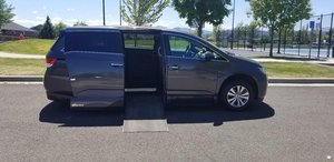 Used Wheelchair Van For Sale: 2016 Honda Odyssey SE Wheelchair Accessible Van For Sale with a VMI Northstar Side Entry Conversion on it. VIN: 5FNRL5H69GB032218