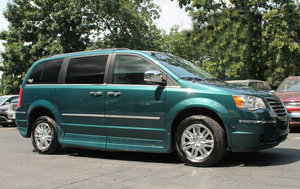 Used Wheelchair Van For Sale: 2009 Chrysler Town & Country LT Wheelchair Accessible Van For Sale with a Rollx 11 Inch Drop Floor Conversion With In-the-floor Ramp on it. VIN: 48409B