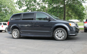 Used Wheelchair Van For Sale: 2013 Dodge Grand Caravan EX Wheelchair Accessible Van For Sale with a Rollx 11 Inch Drop Floor Conversion With Foldout Ramp on it. VIN: 48757B