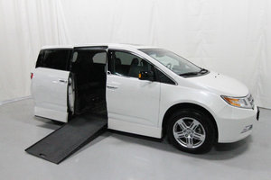 Used Wheelchair Van For Sale: 2012 Honda Odyssey Touring Wheelchair Accessible Van For Sale with a Rollx 11 Inch Drop Floor Conversion with In-the-floor Ramp on it. VIN: 49739