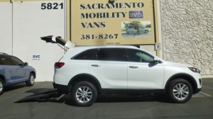 Used Wheelchair Van For Sale: 2016 Kia Sorento  Wheelchair Accessible Van For Sale with a Freedom Motors - Manual Chrysler Rear Entry on it. VIN: 5XYPG4A31GG126950