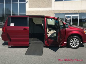 Used Wheelchair Van For Sale: 2016 Dodge Grand Caravan SXT Wheelchair Accessible Van For Sale with a VMI Dodge Northstar on it. VIN: 2C4RDGCG0GR162157