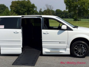 New Wheelchair Van For Sale: 2017 Dodge Grand Caravan  Wheelchair Accessible Van For Sale with a BraunAbility Dodge Entervan Xi Infloor on it. VIN: 2C4RDGEG88HR712980